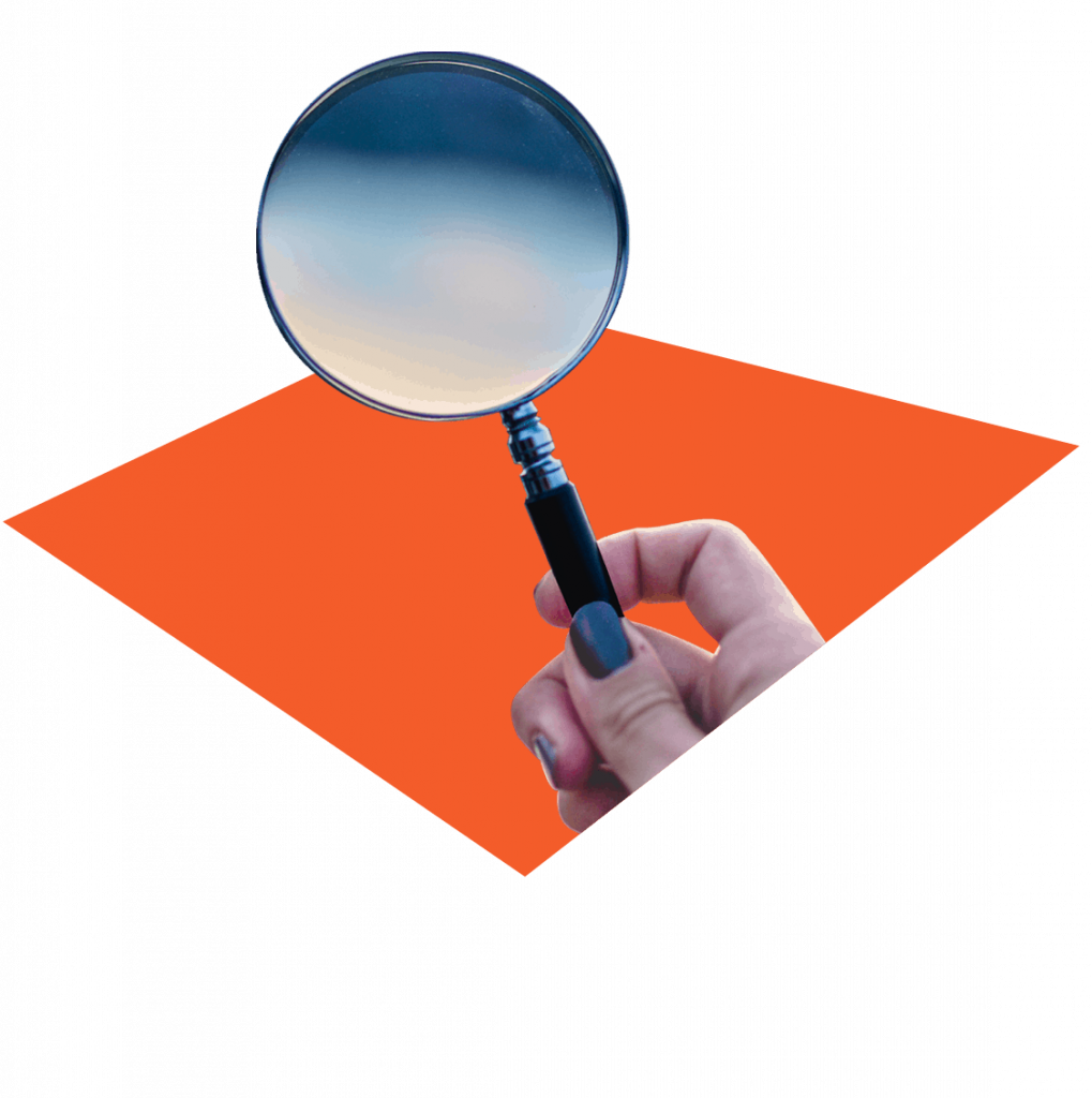 Cutout of person holding a magnifying glass