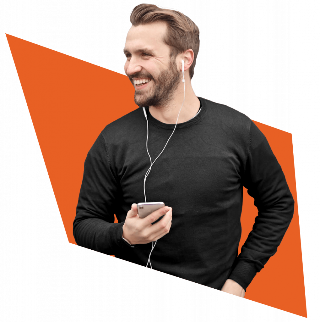 Smiling man using his phone with headphones